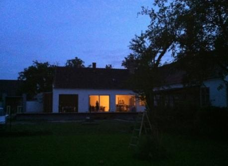 Look from the Garden to the house at night