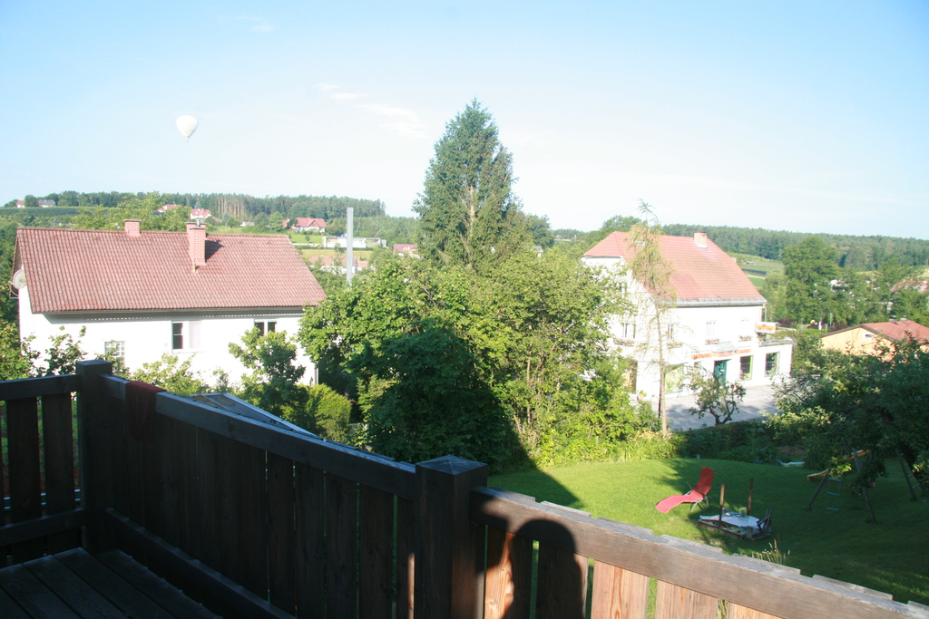 view from our terrace, on the sky a hot air ballon, typical for our area