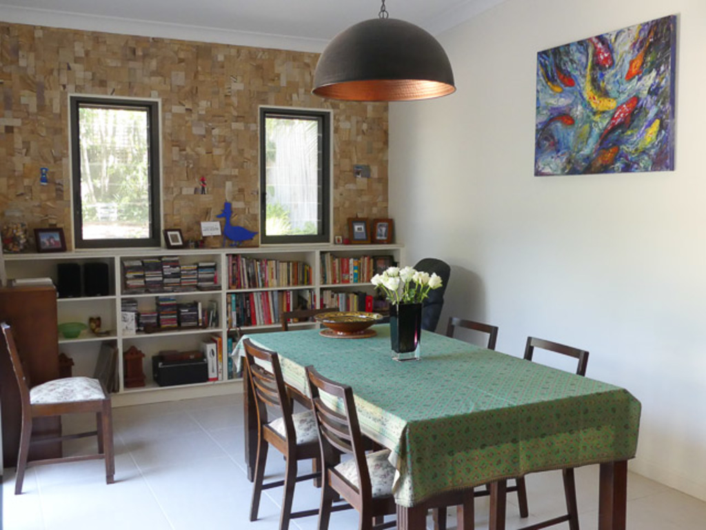 Our new dining room with sandstone wall and plenty of cookbooks