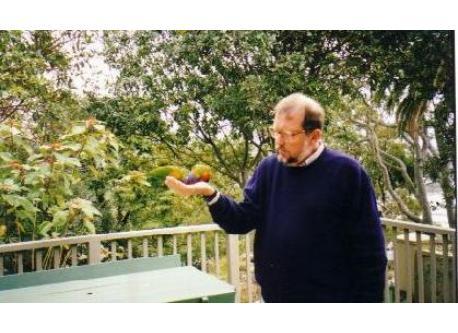 Brian feeding parrots on deck