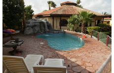 Pool with jacuzzi and waterfall