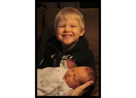 Lucas holding Gabriel