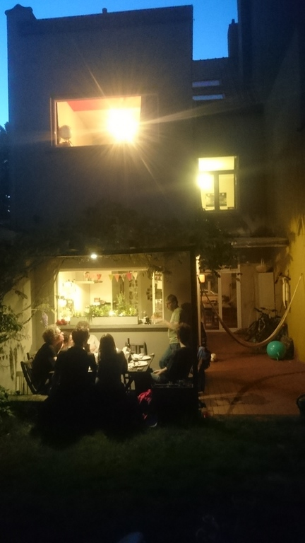 enjoying backyard on a warm night with friends
