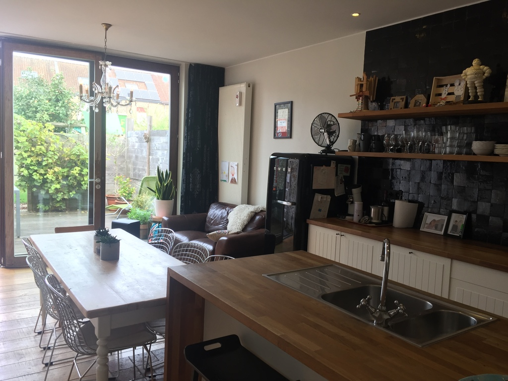 Sunny kitchen with big with window To the private and cosy terrace and garden.