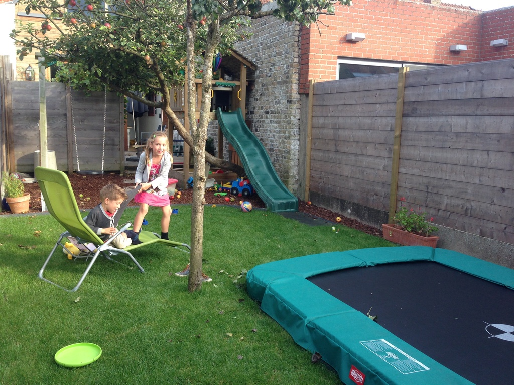 terrace and garden with swing, sandbox, slide and trampoline
