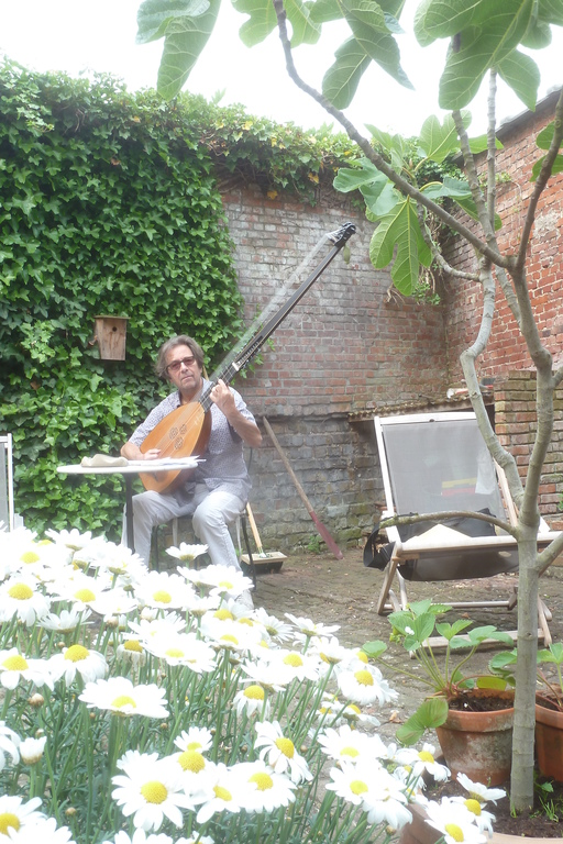 My partner, Philippe, playing archluth in the yard.