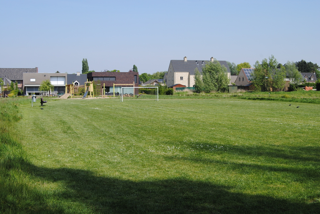 football field and playground just across the street
