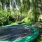 The big trampoline in the garden, next to the sandpit