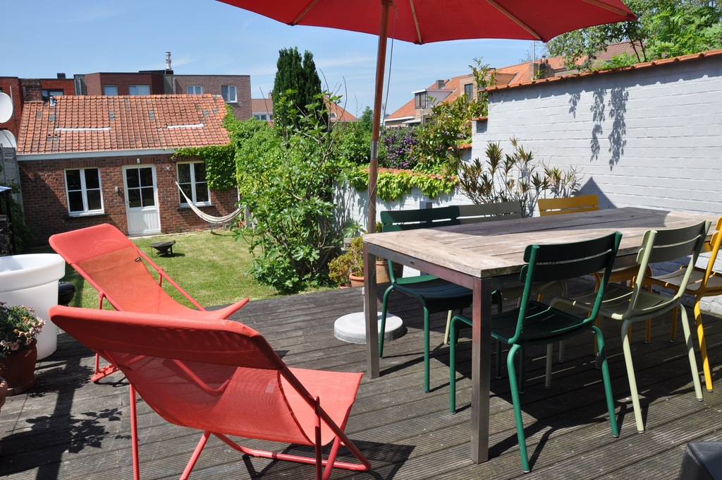 Our terrace in wood and with good orientation (sun until late in the evening)