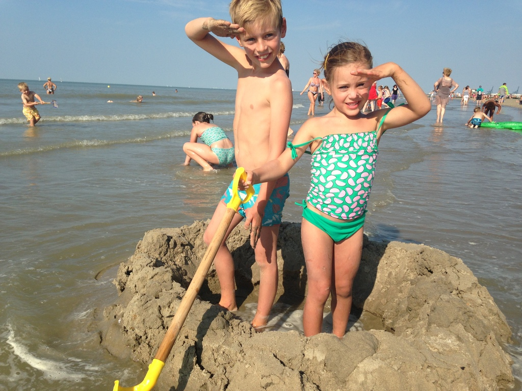 Timon and Jutta at the North sea building a castle in the sand