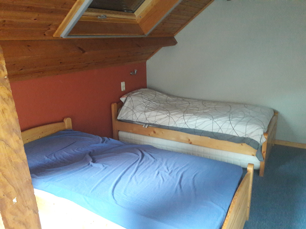 Boys room in studio with 2 single beds
