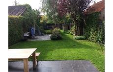 Cosy half-open house with big garden!
