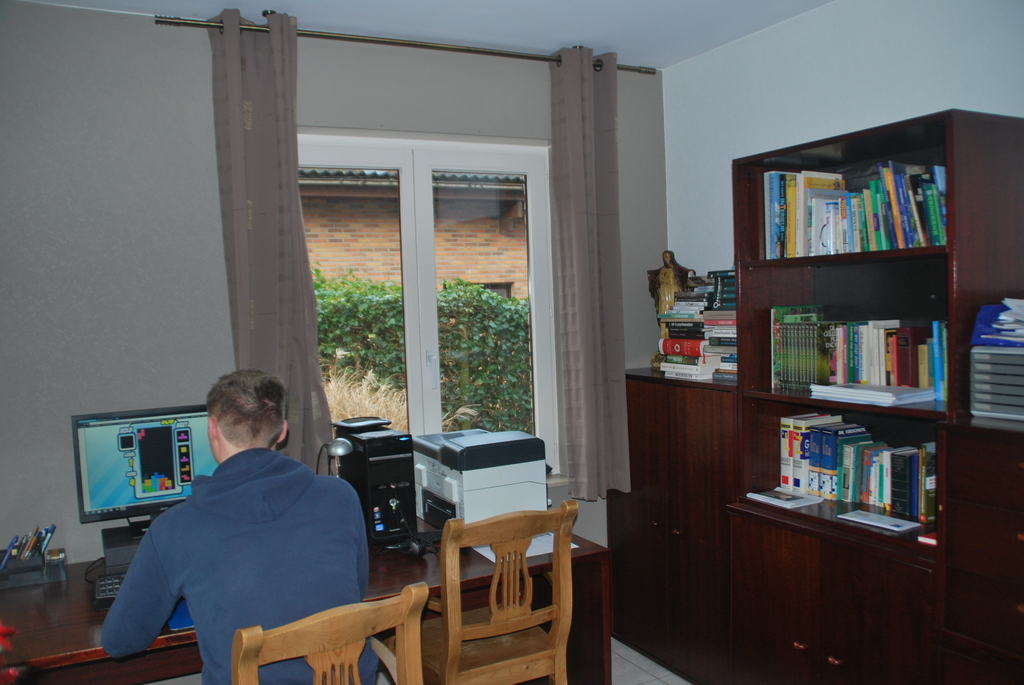 Pieter working in the study