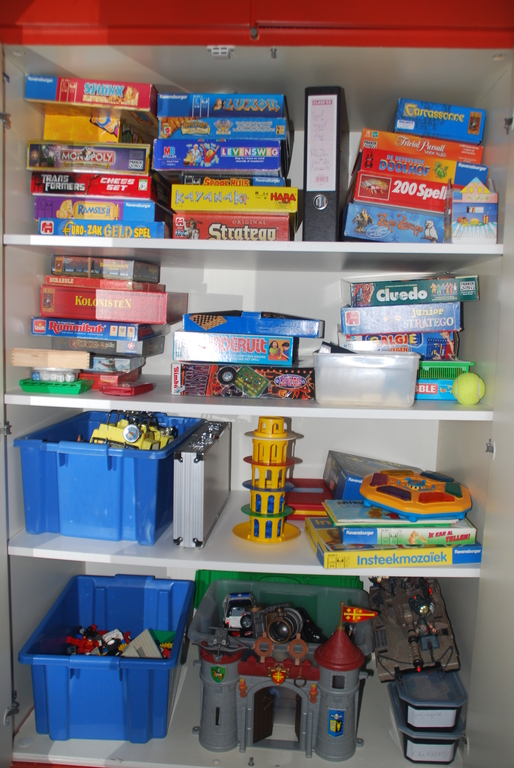 our closet with toys and party games