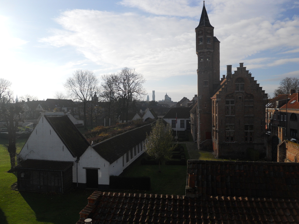 View from the backside bedroom towards the English garden of the archery club with the towers of Bruges on the horizon