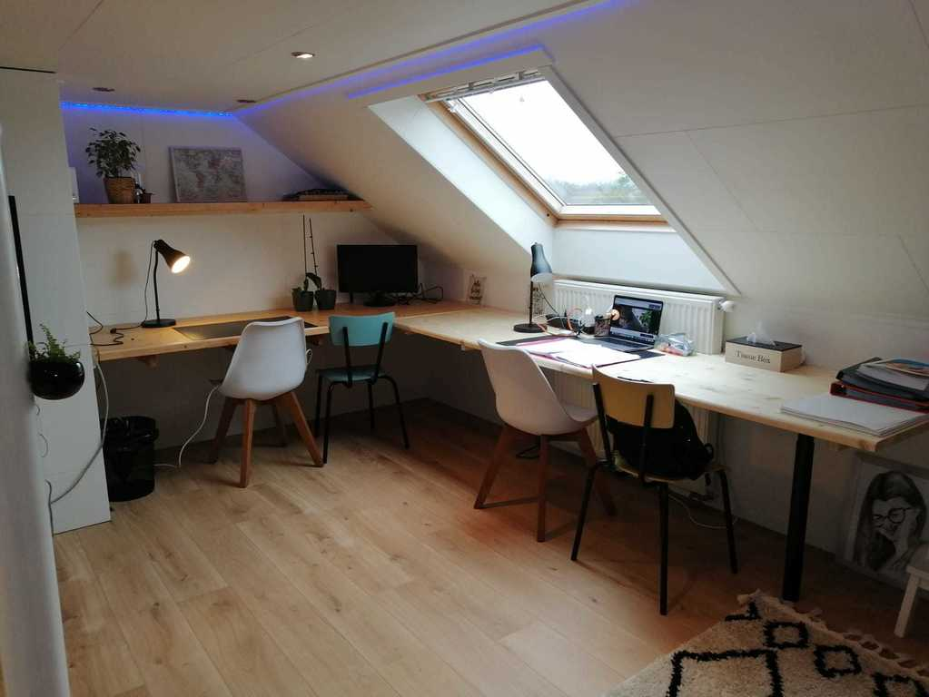 attic with large desk