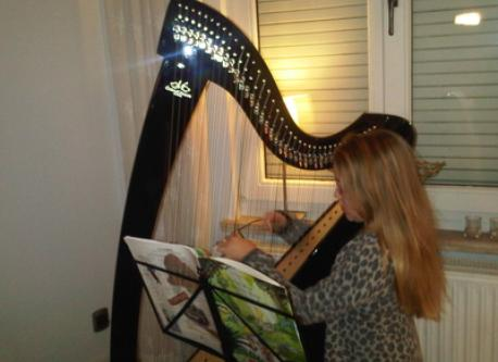 Elena playing the harp