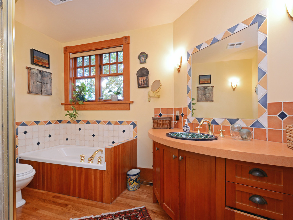 Bathroon #1 off master bedroom has tub, shower, custom-made sink area w/talavera sink from Mexico.