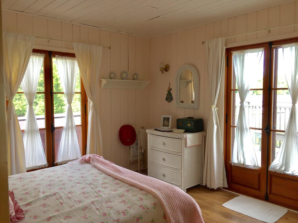 This bedroom as well features French doors that open onto the deck.
