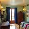 I love the vintage old school feel of these rooms two rooms that share an adjoining bathroom of their own