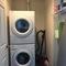 Room with washing machine and dryer machine.