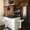 Kitchen with dishwasher, cooker, fridge, freezer and microwave