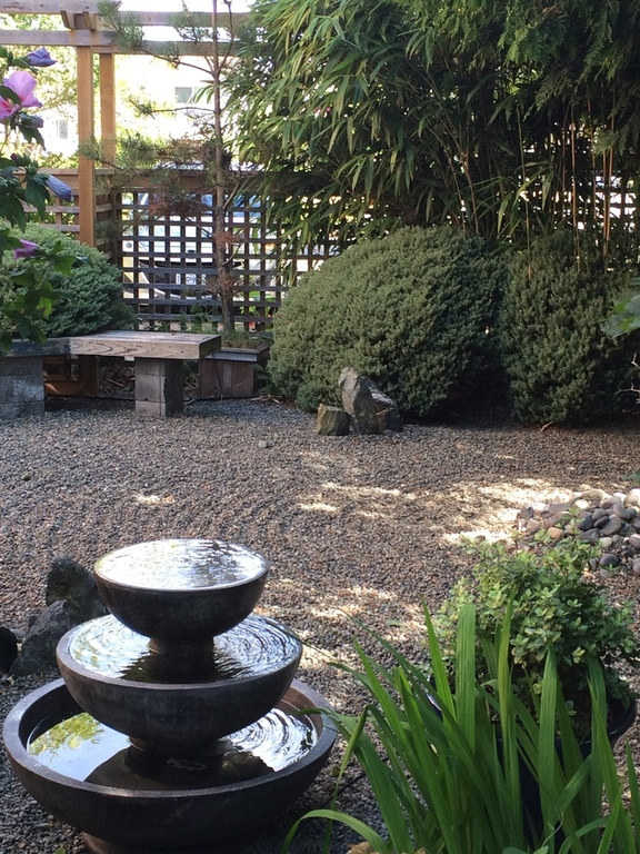 Japanese style gravel garden at side of house