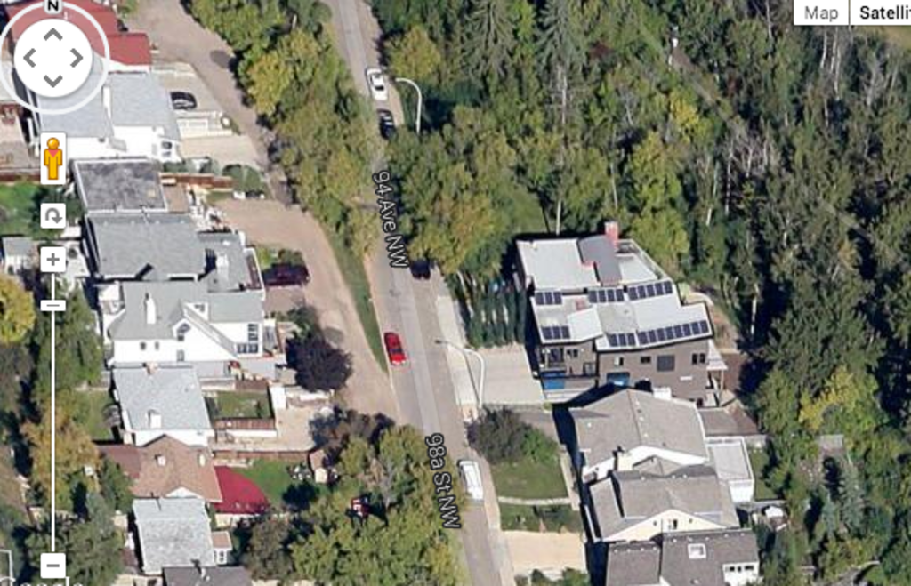 Satellite view of our house showing solar panels on roof and proximity to ravine