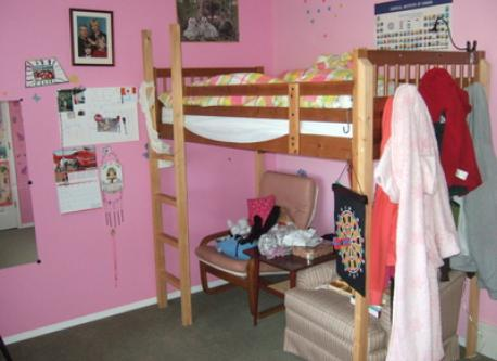 One of the children's bedrooms with loft bed