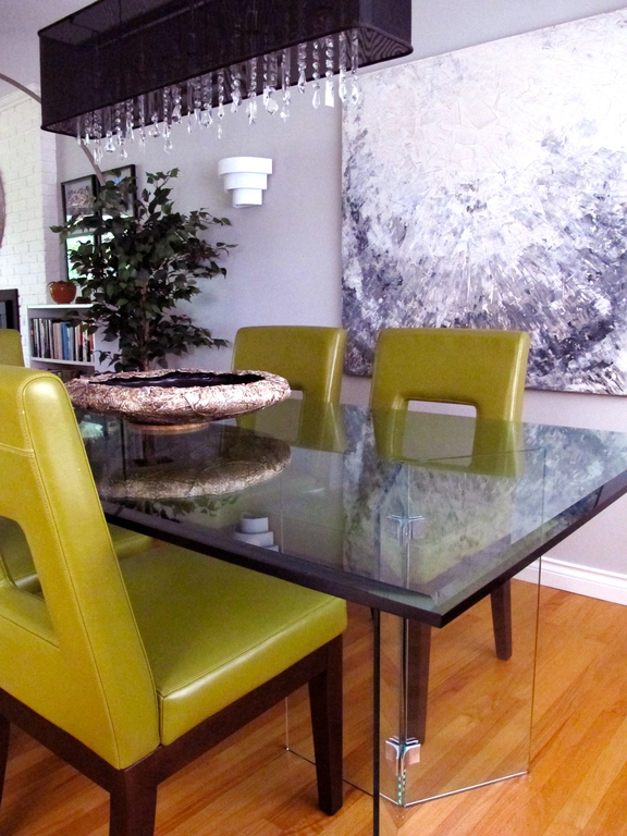 Elegant dining room with contemporary glass table & comfortable leather chairs
