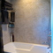 Luxurious bathroom with marble soaker tub and shower