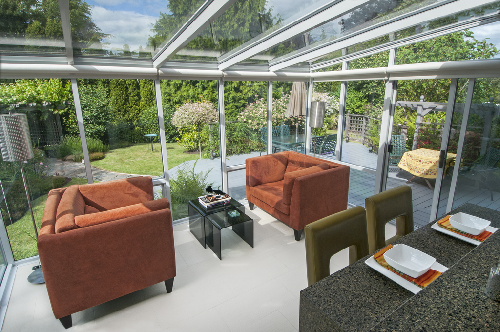 The glass Solarium off the kitchen allows rear garden enjoyment all year round