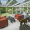The glass Solarium off the kitchen allows rear garden enjoyment all year round