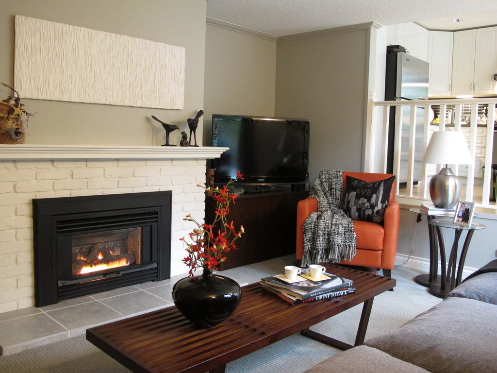 Another view of the main floor family room with cozy fireplace and flat screen TV
