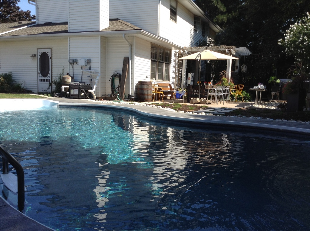 Heated in ground salt water pool, hot tub, BBQ, trampoline, fenced in yard.