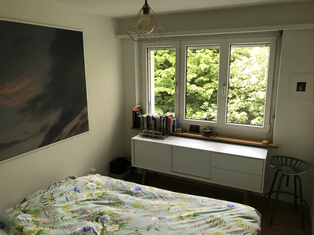 masters bedroom with contemporary art photograpy