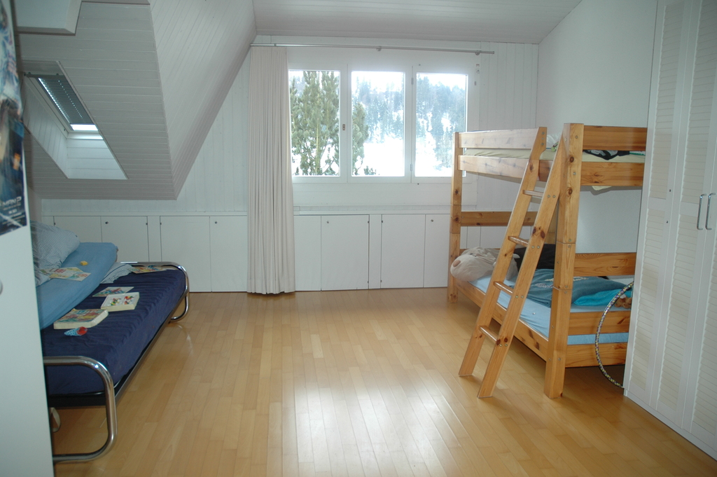 The big bedroom of the kids with three beds.
