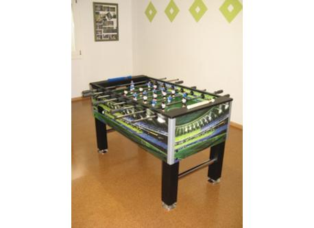 the table-football is staying in the callar. The adults and children can play with it
