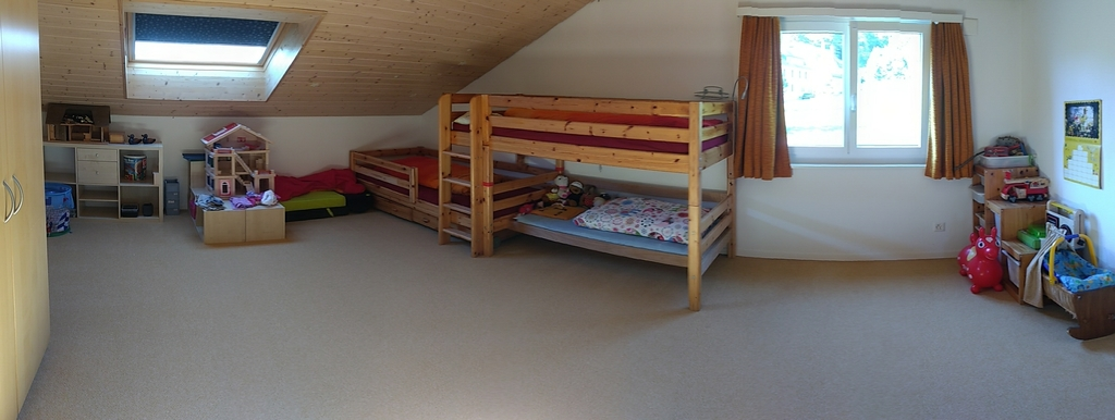 Large children's room with three beds