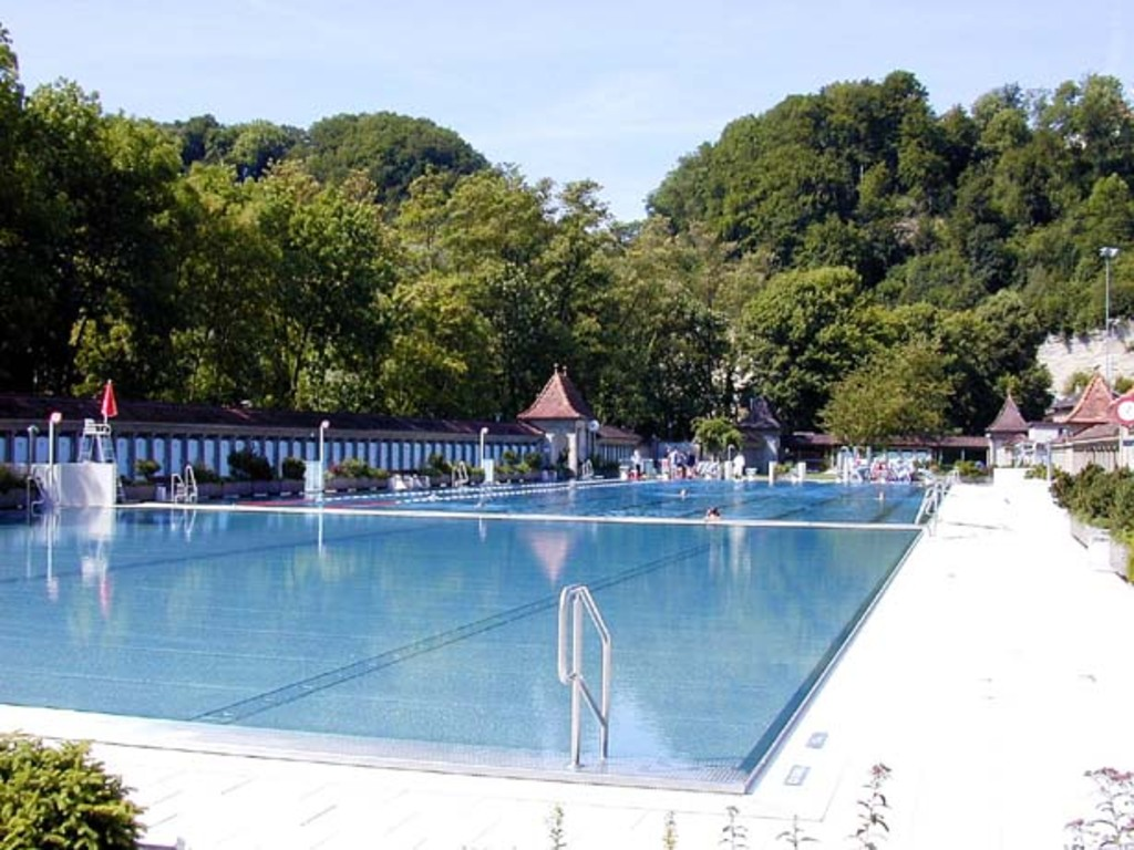 Take a dip in the historical swimming pool beside the river