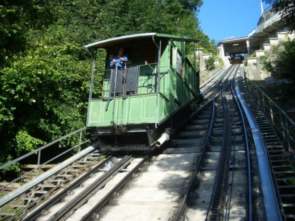 The historical funiculaire will take you down to the riverside and the swimming pool