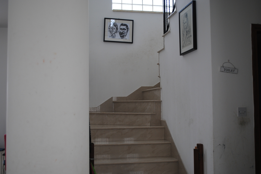Stairway to upstairs where the 4 bedrooms are located.
