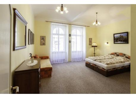 Bedroom with king-size double bed and foldable sofa.