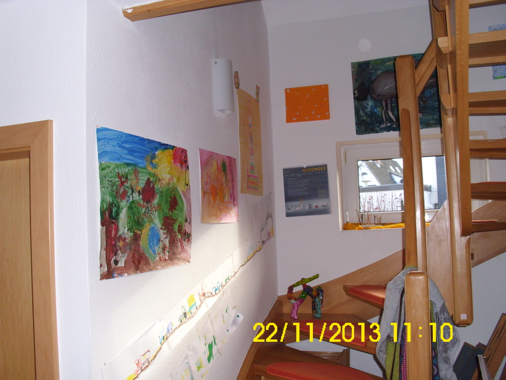 Staircase with our children's paintings