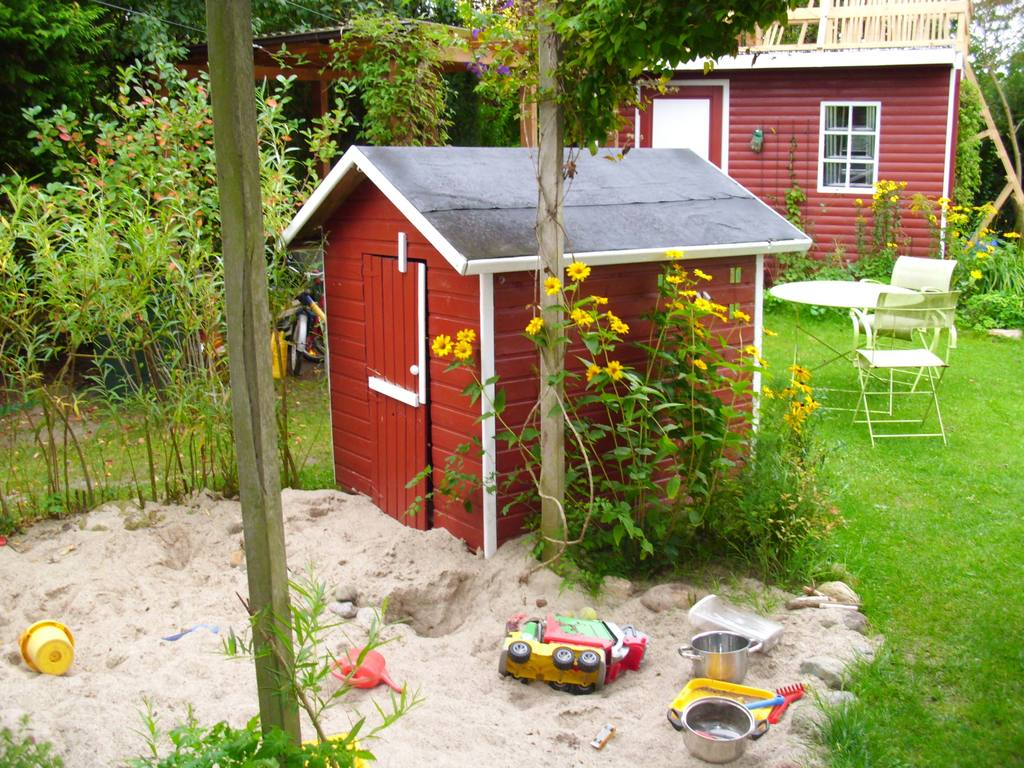 Garden shed and children's playhouse