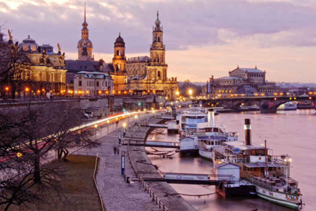 banks of the river Elbe with historical baroque center and paddle steamer boats