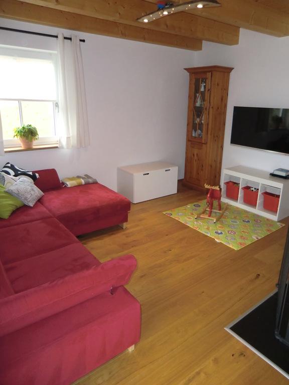 TV and big sofa.