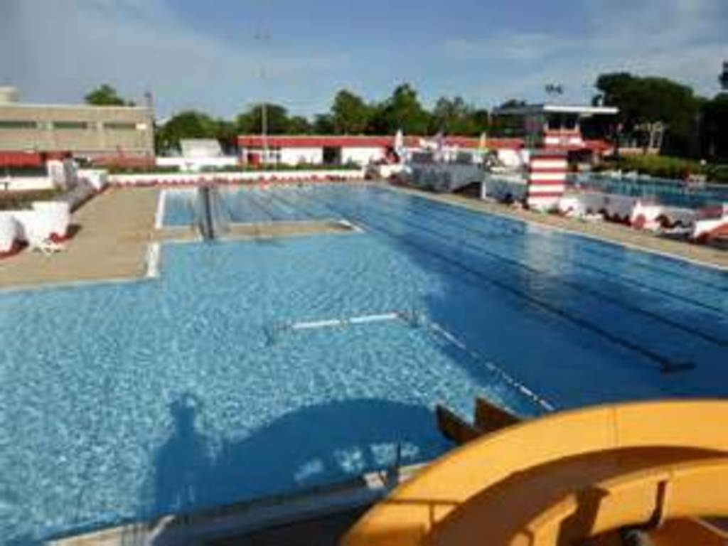 swimming pool with 50m olympic pool and several childrens pools - 1 km from our house 5min by bike
