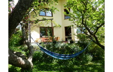 Relaxing under the apple trees or at the terrace
