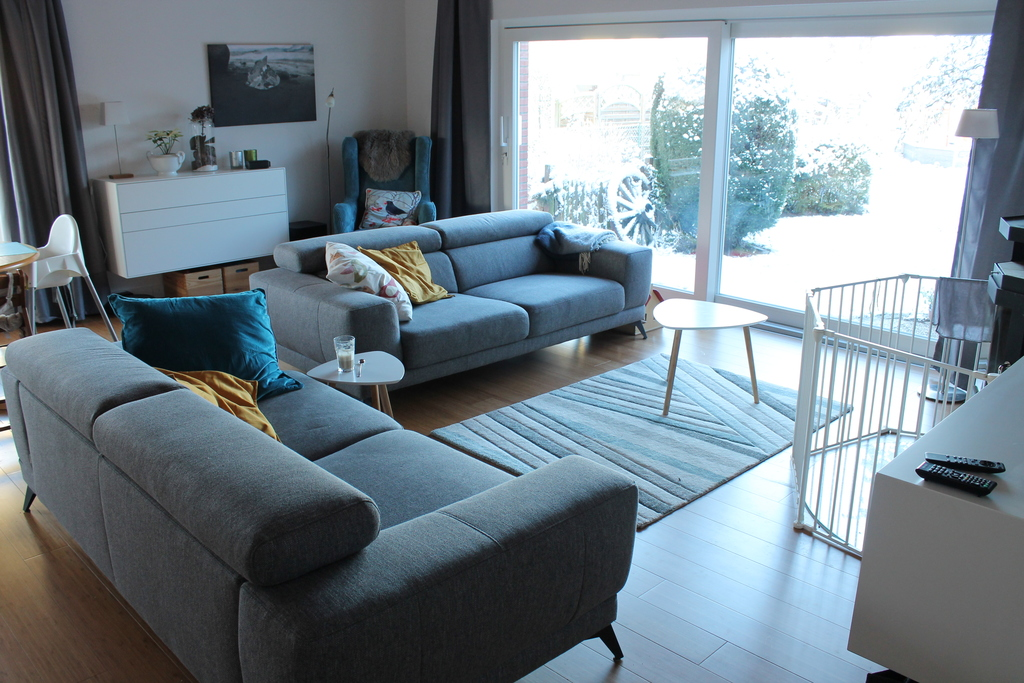 new living room with sofas and rear window into the garden